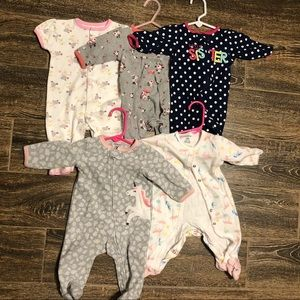 32 0-3 month sleepers. Mostly Carters brand
